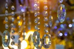 Achtergrond van de kristallen in de opslag van gloeilampen en lampen stock afbeeldingen