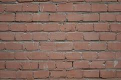 Achtergrond van de rode textuur van het bakstenen muurpatroon Groot voor graffitiinschrijvingen stock foto's