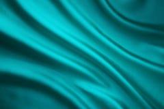 Achtergrond van de stoffen de Golvende Zijde, Teal Satin Cloth Crumpled Wave royalty-vrije stock foto