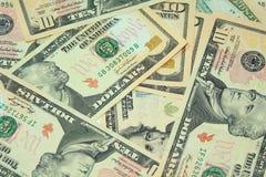 Achtergrond van dollarrekeningen stock afbeeldingen