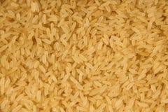 Achtergrond van een ruwe langkorrelige rijst Royalty-vrije Stock Foto