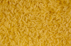 Achtergrond van een ruwe langkorrelige rijst Stock Foto's