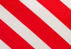 Achtergrond van een stof met rode en witte stroken Stock Afbeelding
