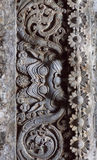 Achtergrond van gesneden patronen op historische muren van Indische steentempel, India De tempel bouwde 1150 in Karnataka-staat i Stock Afbeeldingen