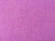Achtergrond van geweven purpere ruwe stof Stock Fotografie