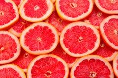 Achtergrond van grapefruit de rode sappige plakken royalty-vrije stock foto's