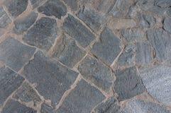 Achtergrond van grijze vlakke stenen stock afbeelding