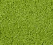 Achtergrond van groen poeder, dichte omhooggaand van de grensoppervlakte van gepoederd stock foto