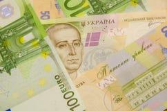 Achtergrond van het geld van de Oekraïne en de Europese Unie Stock Afbeelding