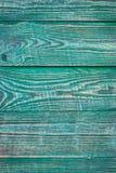 Achtergrond van houten geweven raad met sporen van groene verf verticaal stock afbeelding