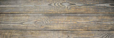 Achtergrond van houten textuurraad met gele kleurenresten van grijze verf horizontaal natalia royalty-vrije stock afbeeldingen