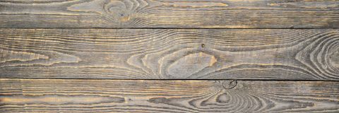 Achtergrond van houten textuurraad met gele kleurenresten van grijze verf natalia stock foto's