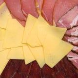 Achtergrond van kaas en vlees Stock Afbeeldingen