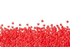 Achtergrond van kleine rode harten op wit Exemplaar ruimtetekst royalty-vrije stock fotografie