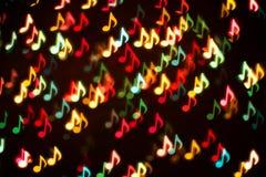 Achtergrond van kleurrijke muzieknota's stock foto