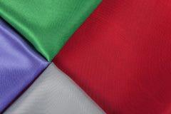 Achtergrond van kleurrijke stoffen rode groene parel royalty-vrije stock fotografie