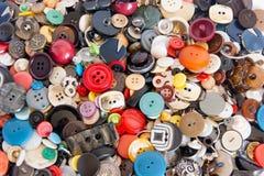 Achtergrond van multi-colored knopen stock afbeelding