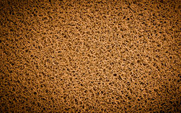 Achtergrond van oranje tapijt, voetschraper, deur Stock Afbeeldingen