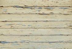 Achtergrond van oud in gele raad wordt geschilderd die stock fotografie
