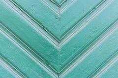 Achtergrond van oud geschilderd groen raads Driehoekig patroon naar beneden Stock Foto's
