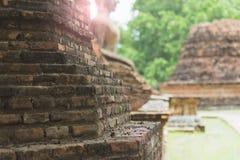 Achtergrond van oude bakstenen muur met Boedha Stock Foto