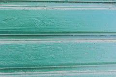 Achtergrond van oude geschilderde groene horizontaraad stock fotografie