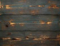 Achtergrond van oude uitstekende houten raad van groene kleur Sterk versleten en gekrast stock foto