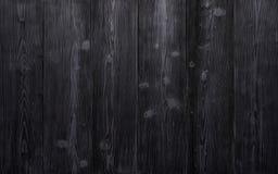 Achtergrond van oude uitstekende zwarte houten raad Sterk versleten en gekrast stock foto's