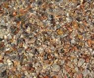 Achtergrond van overzeese stenen met water royalty-vrije stock afbeelding