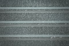 Achtergrond van parallelle grijze strepen Verschillende lijnbreedten De achtergrondstructuur is geschakeerd en korrelig royalty-vrije stock afbeeldingen
