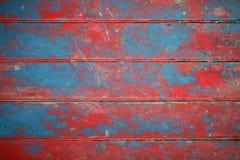 Achtergrond van rode en blauwe geschilderde raad Stock Foto's