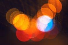 Achtergrond van stads de lichte bokeh, stedelijk straatverkeer bij nacht Royalty-vrije Stock Foto's