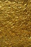 Achtergrond van verfrommeld gouden document Stock Foto's