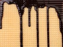 Achtergrond van wafeltje. Stroomchocolade. royalty-vrije stock foto