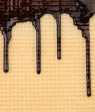 Achtergrond van wafeltje. Stroomchocolade. royalty-vrije stock afbeelding