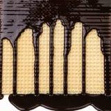 Achtergrond van wafeltje. Stroomchocolade. royalty-vrije stock afbeeldingen