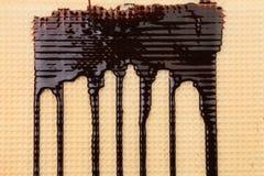 Achtergrond van wafeltje. Stroomchocolade. stock fotografie
