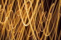 Achtergrond van wervelings de fonkelende gloeiende lijnen stock foto