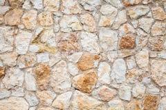 Achtergrondfototextuur van gele grijze steenmuur Royalty-vrije Stock Foto