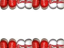 Achtergrondkader van babyschoenen royalty-vrije stock afbeeldingen