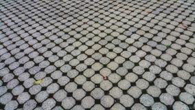 Achtergrondsamenvatting van straatstenen Hoekig naar diepte Optische illusie royalty-vrije stock afbeelding
