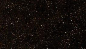 Achtergrondstofgoud op zwarte achtergrond Motiesamenvatting van deeltjes stock footage