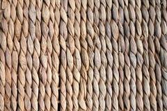Achtergrondtextuur van beige of stro gekleurde rijs of seagrass stock fotografie