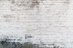 Achtergrondtextuur van een oude witte bakstenen muur stock foto's