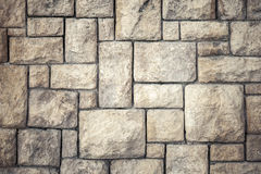 Achtergrondtextuur van oude bruine decoratieve steenmuur Royalty-vrije Stock Foto's