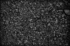 Achtergrondtextuur van ruw asfalt; Zwarte textuurachtergrond; Stock Foto