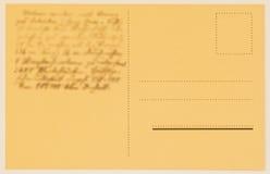 Achterkant van een portkaart met geschreven teksten, gelukwensen De spatie van Grunge achtereind Gerimpelde (document) textuur Co Royalty-vrije Stock Foto