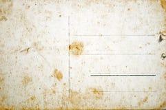 Achterkant van lege grungeprentbriefkaar Stock Foto's