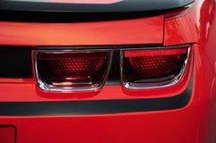 Achterlichten van rode sportwagen Stock Foto's