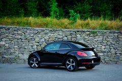 Achterlinkerkantmening van cabriolet mening van de sport de Duitse auto van grondoppervlakte royalty-vrije stock fotografie
